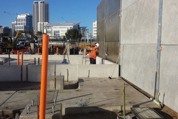 applying anti graffiti coating to large wall