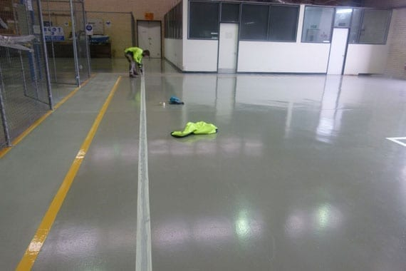 applying safety lines on flooring