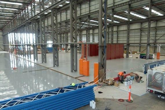 work in progress on flooring large industrial unit