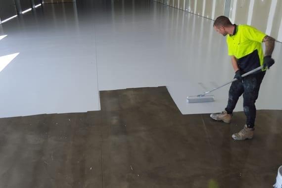 applying coating to floor